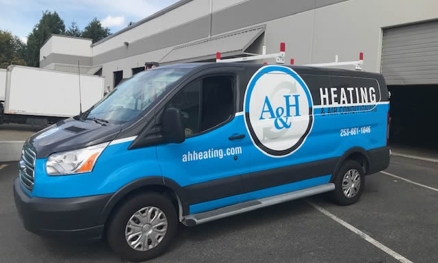 A & H Heating Van in Front of Business Building
